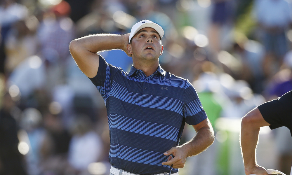 Gary Woodland pauses on the 18th green after his win in a one-hole playoff against Chez Reavie for the final round of the Waste Management Phoenix Open golf tournament Sunday, Feb. 4, 2018, in Scottsdale, Ariz. (AP Photo/Ross D. Franklin)