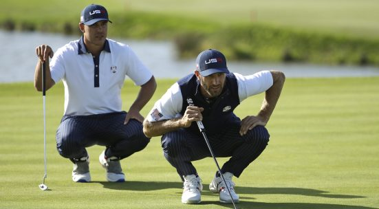 Dustin Johnson of the US, right, and Brooks Koepka of the US line up a putt during a foursome match on the second day of the 42nd Ryder Cup at Le Golf National in Saint-Quentin-en-Yvelines, outside Paris, France, Saturday, Sept. 29, 2018. (AP Photo/Matt Dunham)
