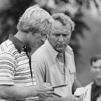 Golfers Arnold Palmer, right and Jack Nicklaus check over a card telling during a practice round for the 1974 PGA Championship. (AP Photo)