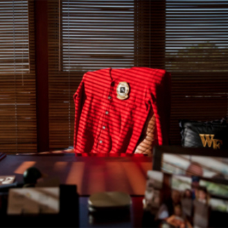 Arnold Palmer's red cardigan rests at his desk in his home office. (Golfweek File)