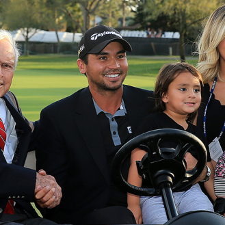 Jason Day with his wife, Ellie, son, Dash and daughter, Lucy pose with Arnold Palmer after Day won the 2016 Arnold Palmer Invitational at Bay Hill Club and Lodge. (Golfweek/Tracy Wilcox)