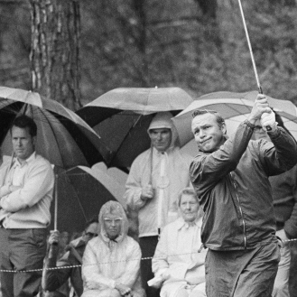 Arnold Palmer was ready to play in all sorts of weather - like here at Augusta in 1971. (AP Photo)