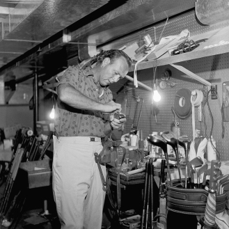 Always the craftsman, Arnold Palmer refines his clubs at his Latrobe, Pa., workshop in 1962. (AP Photo)