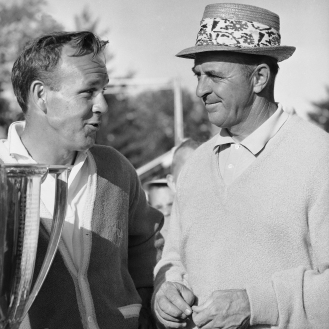 In 1965, it was Arnold Palmer's turn to help Jack Nicklaus after Nicklaus won the Masters. (Getty Images)