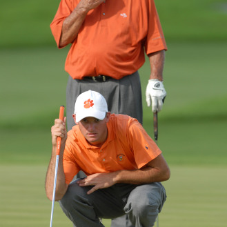 Arnold Palmer and grandson Sam Saunders line up their putt during the 2007 Del Webb Father/Son Challenge golf tournament in Orlando. (AP Photo/Phelan M. Ebenhack)