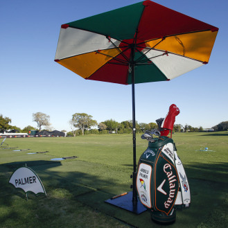 A tee box on the range is reserved containing a golf bag and umbrella for Arnold Palmer during the first round of the Arnold Palmer Invitational golf tournament in 2017. (Reinhold Matay-USA TODAY Sports)