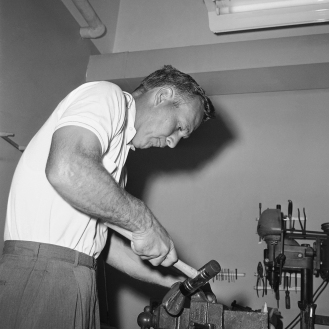 Palmer works on his gear at Olympia Fields in 1961.