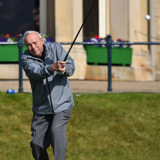 Winner of The Open in 1961 and 1962, US golfer Arnold Palmer plays from the 1st tee during the Champion Golfers' Challenge on The Old Course at St Andrews in 2015. (Getty Images)