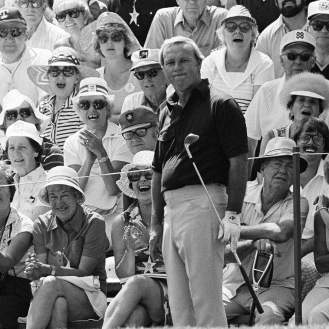The gallery on the 18th hole looks pleased with a chip to the green, but Arnold Palmer, center, looks less than pleased with his shot during a practice round at Cherry Hills Country Club, June 12, 1978, Cherry Hills, Colo. Palmer, who won the 1960 US Open here, was among many golfers making practice rounds before Thursdays opening round of the 78th U.S. Open. (AP Photo)
