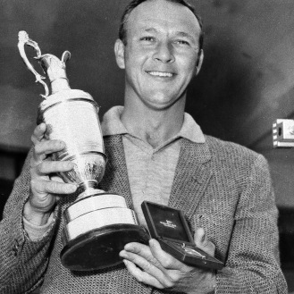 Arnold Palmer smiles with his trophy and medal after winning the British Open Golf Championship by a single stroke at Royal Birkdale 1961. (AP Photo)