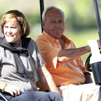Arnold Palmer (R) and his wife Kit Palmer drive near the 16th hole during the third round of the Bay Hill Invitational at Bay Hill Club on March 18, 2006.