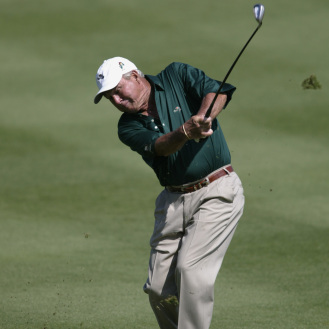 Arnold Palmer hits a shot during the first round of the Bay Hill Invitational at the Bay Hill Club and Lodge in Orlando, Fla., in 2002.