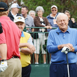 Jack Nicklaus (left) and Arnold Palmer share a laugh before teeing off on No. 1 during the first round of the Father/Son Challenge at the Ritz-Carlton Golf Club in Orlando in this undated image. (File)