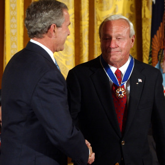 Former President George W. Bush presents Arnold Palmer, right, with the Presidential Medal of Freedom, the nation's highest civil award, during a ceremony at the White House in 2004. (AP Photo)