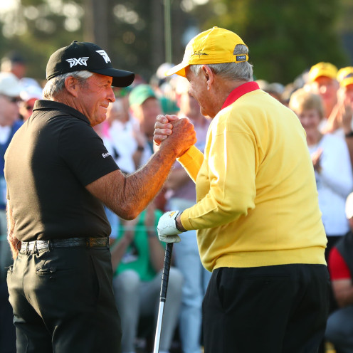 Gary Player (left) and Jack Nicklaus greet each other after hitting ceremonial tee shots on the 1st hole during the first round of The Masters. (Rob Schumacher-USA TODAY Sports)