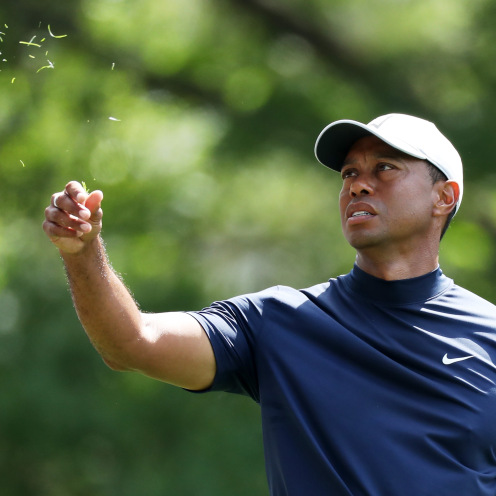 Tiger Woods of the United States checks the wind prior to playing a shot during the first round of the Masters. (David Cannon/Getty Images)