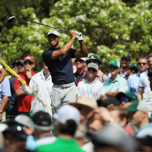 Tiger Woods of the United States plays his shot from the fifth tee during the first round of the Masters. (Mike Ehrmann/Getty Images)