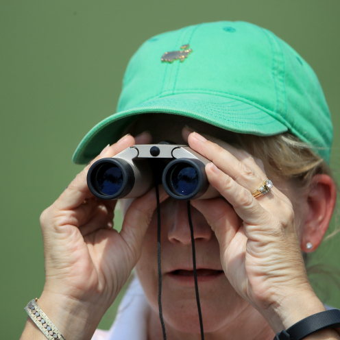 A patron uses binoculars during the first round of the Masters at Augusta National. (Andrew Redington/Getty Images)
