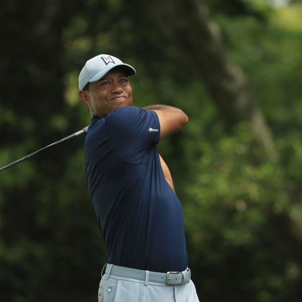 Tiger Woods of the United States plays his shot from the second tee during the first round of the Masters at Augusta National Golf Club. (Mike Ehrmann/Getty Images)